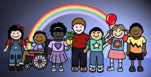 children in front of a rainbow